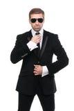 Elegancki ochroniarz z okularami przeciwsłonecznymi obrazy royalty free
