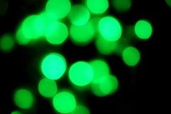 Eleganckiego abstrakt zieleni bokeh świateł kropek defocused tło Obrazy Royalty Free