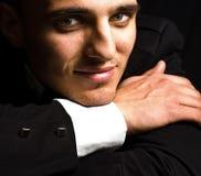 eleganckiego oczu przystojnego mężczyzna zmysłowy uśmiech Zdjęcie Stock
