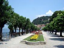 Elegand esplanade of Bellagio, Lake Como, Italy. Beautiful esplanade on the banks of Lake Como, Italy, with elegant and luxurious villas of city if Bellagio on Royalty Free Stock Photography