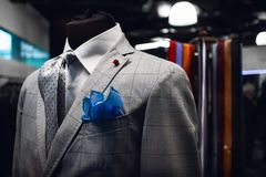 Elegand man`s suite on a mannequin in an italian dress shop. With tie and pocket handkerchief royalty free stock photography