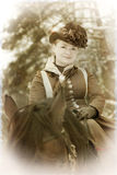 Eleganny woman in riding habit Stock Photography