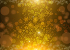Elegant abstract background with Gold glitter sparkles rays lights bokeh and stars. Gold Festive Christmas background.  Royalty Free Stock Photography