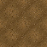 Elegant Sepia Pattern With Bevel. An elegant abstract sepia background depicting swirl designs with a bevel and drop shadow. Seamlessly repeatable Royalty Free Stock Photos