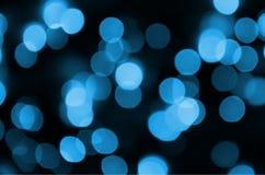 Elegant abstrakt bakgrund för blå festlig jul med många bokehljus Defocused konstnärlig bild Arkivfoto
