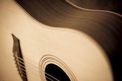 Elegant acoustic guitar. Body closeup Royalty Free Stock Photography
