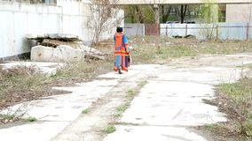 Elegant adult woman walks along a path in the waste-ground. Elegant adult woman walks along a path in the waste-ground or in another abandoned place. Outdoors stock footage