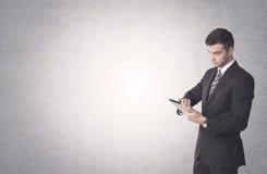 Elegant affärsman med klar bakgrund Arkivbild