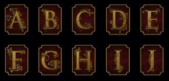 Elegant alfabet som ÄR A-J på röd bakgrund Arkivbild