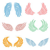 Elegant angel wings with long feather. Angelic symbols isolated vector set. Color angel wing of collection illustration Royalty Free Stock Photos