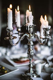 Elegant Antique Candlestick on the Served Table Royalty Free Stock Photo