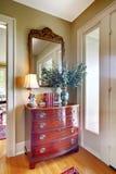 Elegant antique furniture near front door Stock Photos