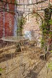Elegant antique patterned iron garden furniture set, high table. And chairs Royalty Free Stock Photography