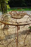 Elegant antique patterned iron garden furniture set, high table. And chairs Stock Photo