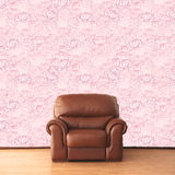 Elegant armchair in vintage interior with pink rose wallpaper Royalty Free Stock Images