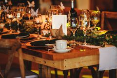 Free Elegant Arrangement Of The Holiday Tableware. Vintage Decoration Of Reception Dinner Table. Rustic Wedding Table Setting In Fancy Stock Photography - 163982662
