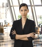 Elegant asian businesswoman in corporate office Royalty Free Stock Images