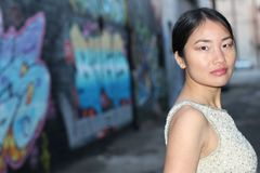 Elegant Asian woman in dark urban alley way isolated with copy space Stock Image