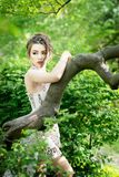 Elegant asian woman in garden, fashion model. Outdoor Royalty Free Stock Photo