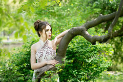 Elegant asian woman in garden, fashion model. Outdoor Stock Photos
