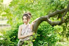 Elegant asian woman in garden, fashion model. Outdoor Royalty Free Stock Photos