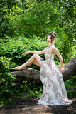Elegant asian woman in garden, fashion model. With tattoo Royalty Free Stock Images