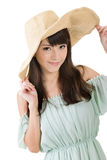 Elegant Asian woman with hat Stock Images