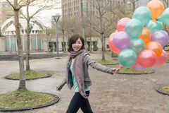 Elegant Asian woman hold balloons Royalty Free Stock Images