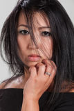 Elegant Asian woman in studio, portrait Royalty Free Stock Image
