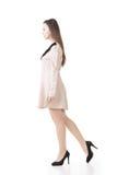 Elegant Asian woman walking Stock Image