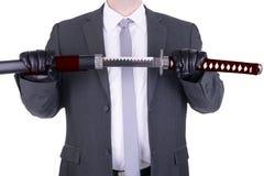 Elegant assassin holding katana. Isolated on white background royalty free stock photography