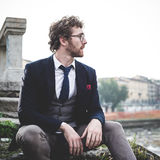 Elegant attractive fashion hipster man lifestyle Stock Photos