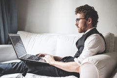 Elegant Attractive Fashion Hipster Man Using Notebook Royalty Free Stock Images