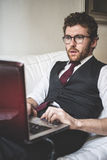 Elegant attractive fashion hipster man using notebook Stock Photo