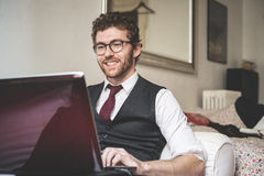 Elegant attractive fashion hipster man using notebook Royalty Free Stock Photo