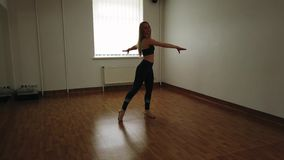 Female dancer training dance while rehearsing in dance studio. Elegant attractive female dancer improvising contemporary style dance while rehearsing in dance stock photos