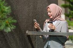 Elegant attractive female muslim office worker