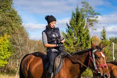 Elegant attractive woman riding a horse Royalty Free Stock Photography