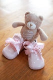Elegant baby shoes with teddy bear Stock Image