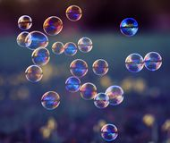 Elegant background with shiny soap bubbles flying over a flowery stock photos