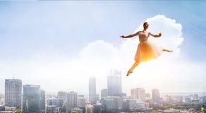 Elegant ballerina dancing. Mixed media stock photography