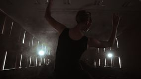 Elegant ballet dancer in black tutu in studio with smoke. And backlit. Elegant ballet dancer in black tutu in studio with smoke. And backlit stock video footage