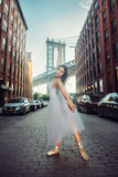 Elegant ballet dancer woman dancing ballet in the city Stock Photo