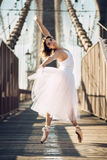 Elegant ballet dancer woman dancing ballet in the city Stock Photography