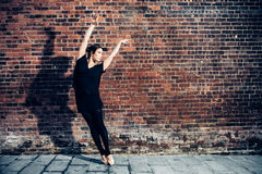 Elegant ballet dancer woman dancing ballet in the city Stock Image