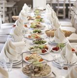Elegant banquet table prepared for conference or party for guests. Royalty Free Stock Photography