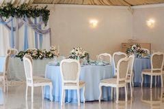 Elegant banquet tables chairs with flowers. wedding decoration i. N a restaurant Royalty Free Stock Images