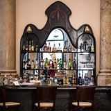 Elegant bar, Cuba. Bar with various alcoholic bottles and glasses royalty free stock photos