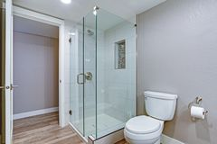 Elegant bathroom with hardwood floor. Elegant bathroom with glass shower and hardwood floor royalty free stock photo