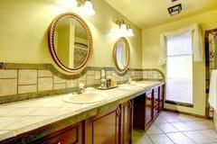 Elegant bathroom with stone wall trim Royalty Free Stock Photo